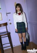 Pretty asian teen babe with tiny tits taking off her school uniform