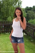 Outdoor pissing scene from a brunette teen Laura Brook in her yard