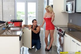 Blonde MILF in tight dress seducing plumber for sex in kitchen