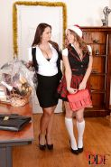 Juggy teacher has some lesbian fun with her bosomy student by X-mas tree