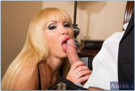 Nikki Benz gives a blowjob and gets her shaved cunt drilled hardcore