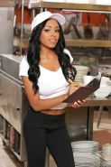 Big tits Ebony babe Anya Ivy poses in sexy uniform while in office