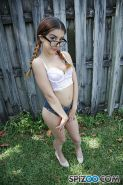 Sally Squirt in glasses and pigtails spreading pussy outside and fucking