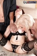 Horny nans Scarlet Andrews and Kim Anh having MMF threesome in stockings