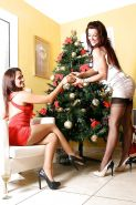 Amazingly sexy ladies have some lesbian humping fun by the Christmas tree
