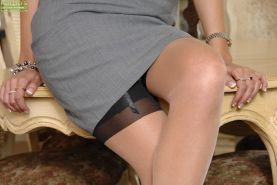 Smiley MILF in black stockings undressing and spreading her pussy lips