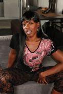 Ebony milf Pepper Deville spreads her awesome buns and shows anus
