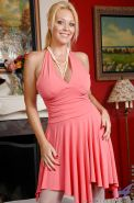 Ravishing mature vixen Charlee Chase stripping and playing with a vibrator