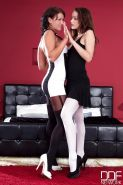 Nia Black and Sophie Lynx top action in rare lesbian scenes