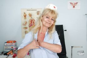 Filthy granny in nurse uniform masturbating her twat with toys