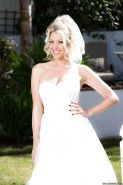 Blonde babe Lexi Lowe showing off nice MILF tits outdoors in wedding dress