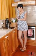 Horny teen Coco De Mar masturbating her shaved poon in the kitchen