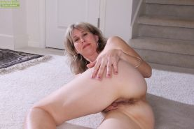 Olive Jones shows her tiny tits and hairy mature pussy while undressing #51365182