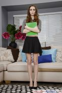 Barely legal coed solo girl Tali Dova flashes upskirt panties in high heels