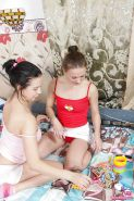 Two young girls in cute socks explore the joys of teen lesbian sex