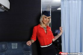 Tattooed blond Kleio Valentien frees big tits from flight attendant uniform