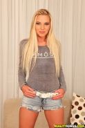 European blondie Angie Koks is undressing her tight jeans shorts