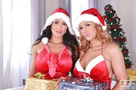 Euro lesbians Kyra Hot and Patty Michova sucking big tits at Christmas