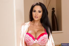 Ava Addams taking off her lingerie and spreading her nylon clad legs