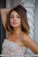 Clothed Euro girl Susana C undresses to pose naked in high heels on rooftop