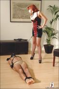 Filthy redhead femdom in stockings treating her bound human pet