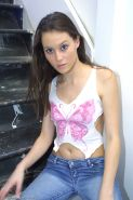 Amateur Latina babe Jassie displaying tiny tits while shedding blue jeans
