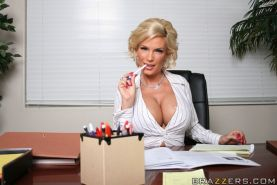 Slutty MILF Diamond Foxxx shows her big tits and pussy in the office