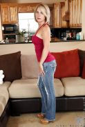 Blonde with red lips Jenny Mason takes off her tight blue jeans
