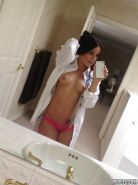 Perky latina sweetie making hot selfies and teasing her shaved slit