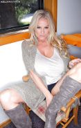 Big boobed blonde MILF Kelly Madison letting massive juggs free