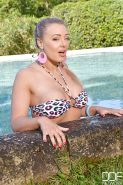 Blonde chick Beth shedding bikini by pool for toying of twat with big dildo