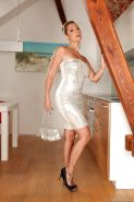 Hot MILF on high heels Daria Glower uncovering her voluptuous curves