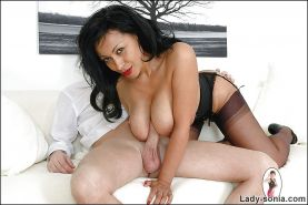Mature fetish lady in stockings pleases hard cock with her hands and jugs
