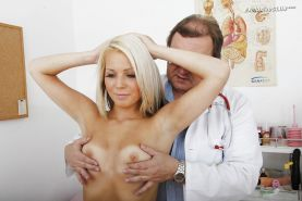 Smiley blondie gets her pussy stuffed with various tools at her gyno exam