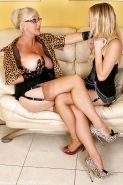 Busty mature bombshell has some lesbian fun with her younger friend