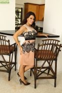 Upskirt posing scene with an big tits milf babe Leena Sky in her kitchen