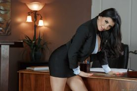 Leggy brunette babe in high heels Romi Rain baring her big tits in office