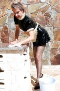 Mature leggy French Maid fantasy in latex & silky smooth stockings