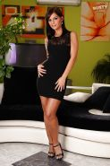 Hot amateur model Black Angelika strutting seductively in black dress