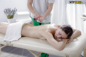 Oiled up brunette Zarina sucking on a dick after getting a massage