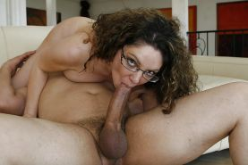 Curly-haired MILF in glasses gets fucked hard and jizzed over her ample ass
