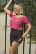Mature blonde Sandy Spain showing off outdoor in stockings and flashing big boobs