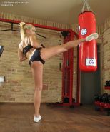 Flexible fitness girl Lea Lexis in shorts toys pussy with dildo at the gym