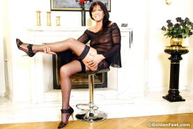 Mature nylon model Lady Sarah flashing stocking tops and thigh