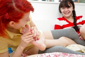 Cute lesbos in socks suck toes and perform freaky foot fetish activities