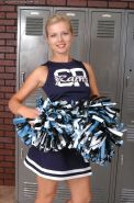 Admirable MILF slipping off her cheerleader uniform and exposing her goods