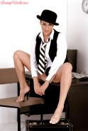 MILF solo girl Linsey Dawn McKenzie posing in hat while exposing huge juggs