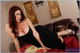 Big busted MILF Tiffany Mynx stripping and spreading her legs