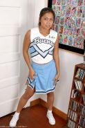 Asian babe spreading shaved teen pussy after shedding cheerleader uniform