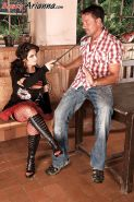 Arianna Sinn looks great in sexy goth outfit as she lets her handsome slave lick her boots and plays with her big tits.